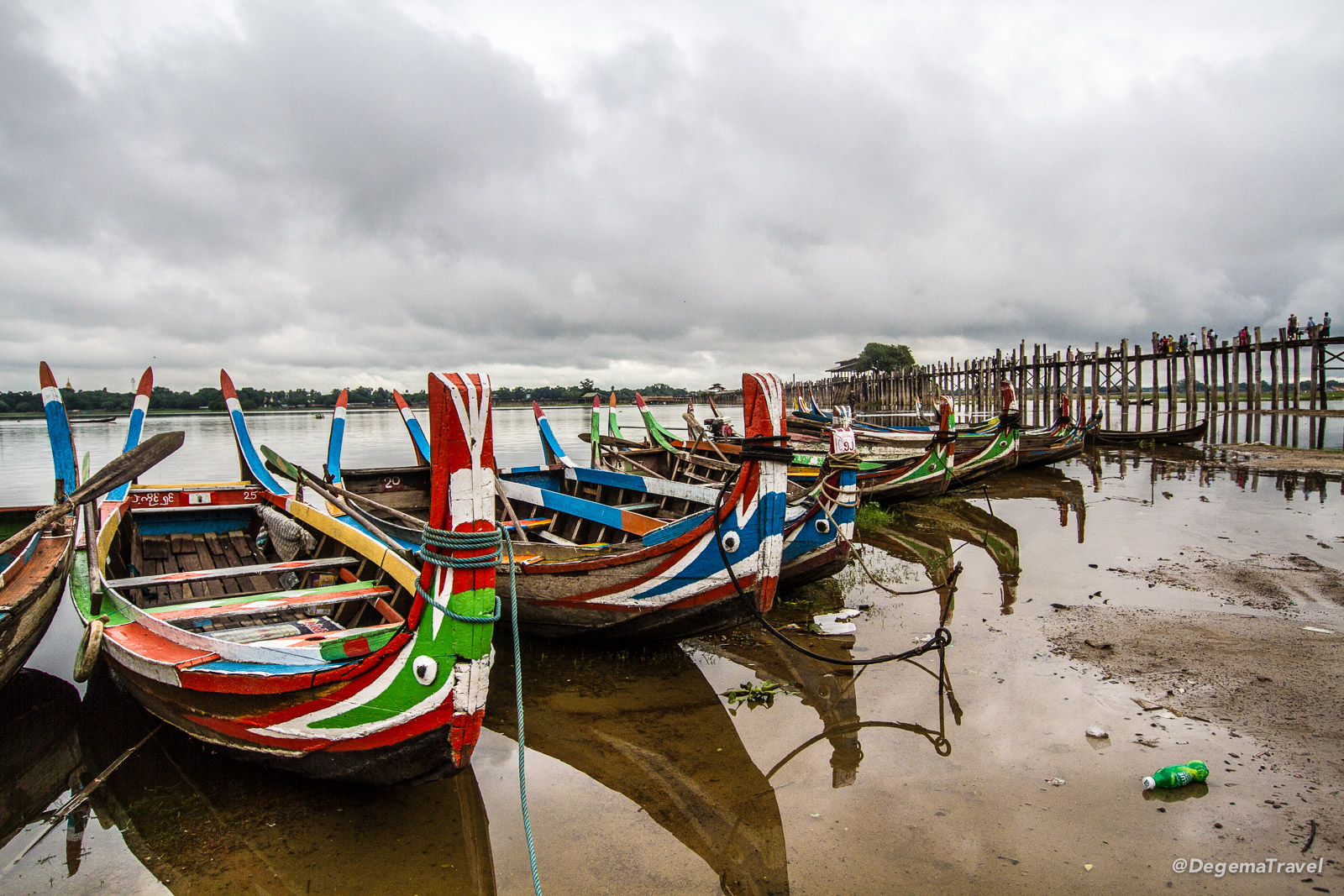 Colourful local boats at U Bein Bridge near Mandalay, Myanmar