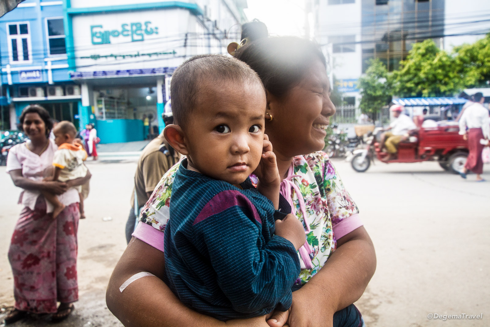 Local child and parent outside Mandalay General Hospital, Myanmar