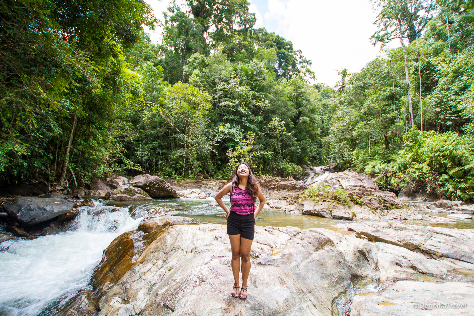 Posing for photos among the waterfalls in Ton Pariwat Wildlife Sanctuary, Thailand