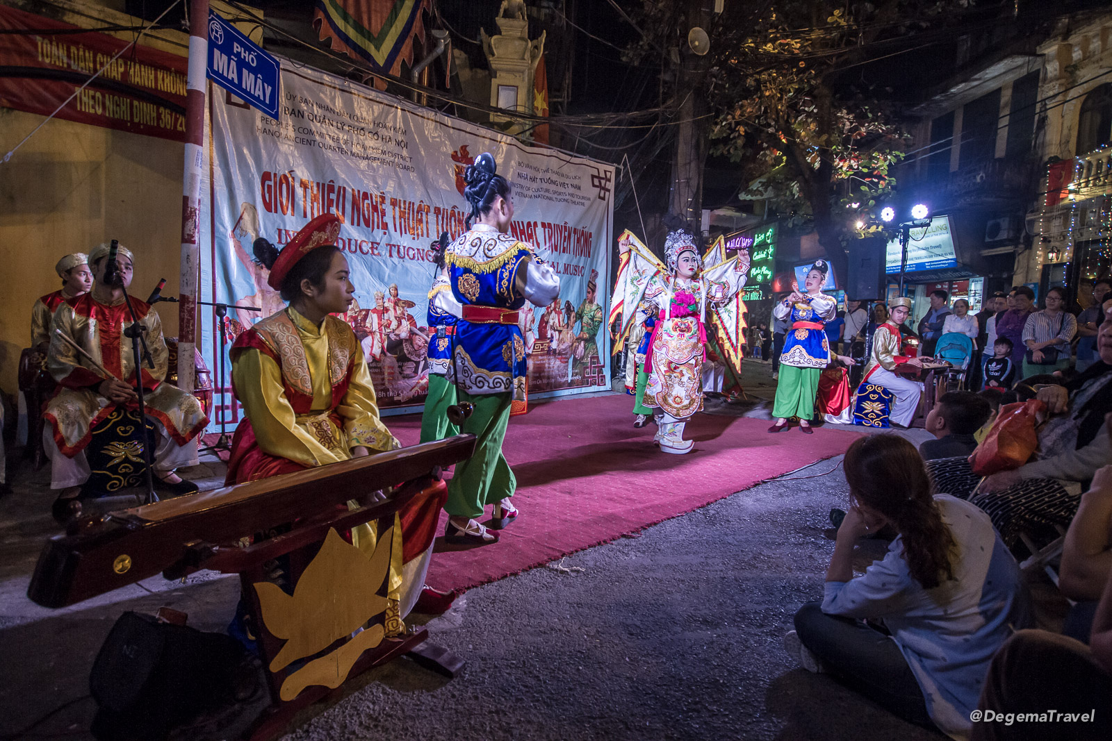 A cultural and musical performance on the streets of the Old Quarter in Hanoi, Vietnam