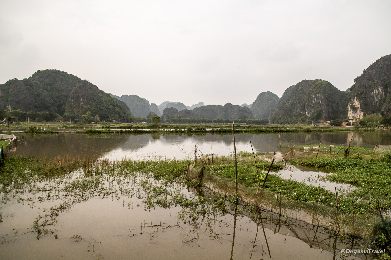 A misty morning in Tam Coc near Ninh Binh, Vietnam