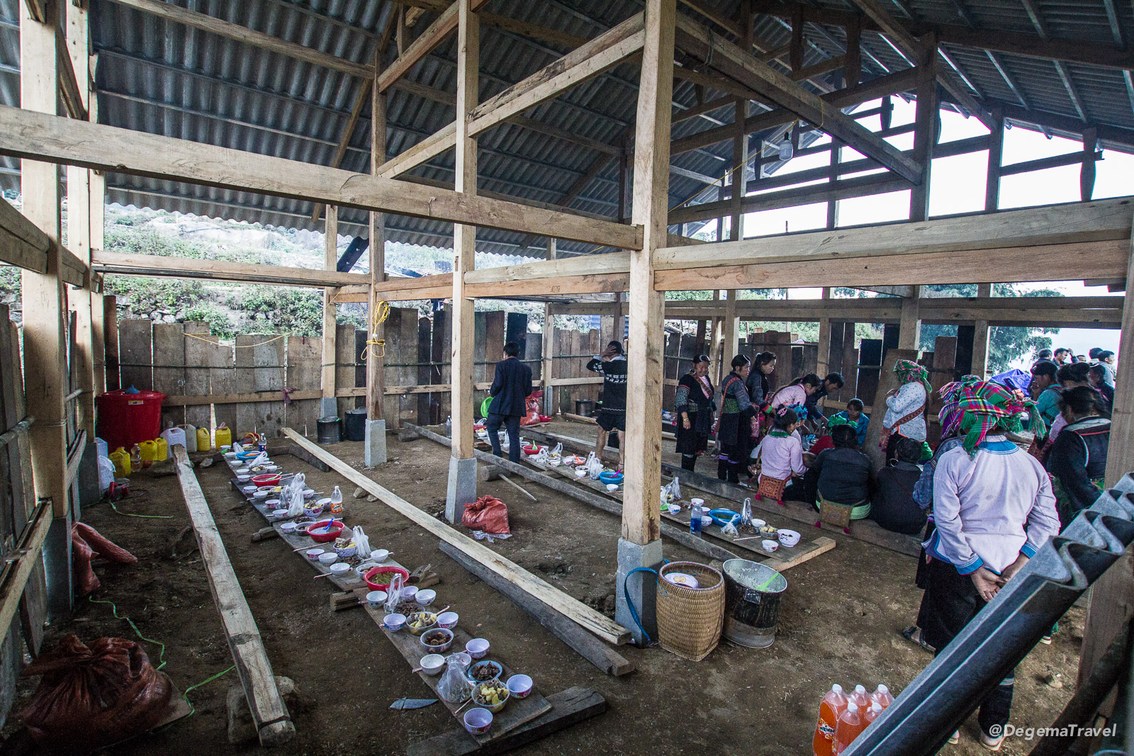 A communal meal laid out in the house under construction in the Mường Hoa Valley near Sapa, Vietnam