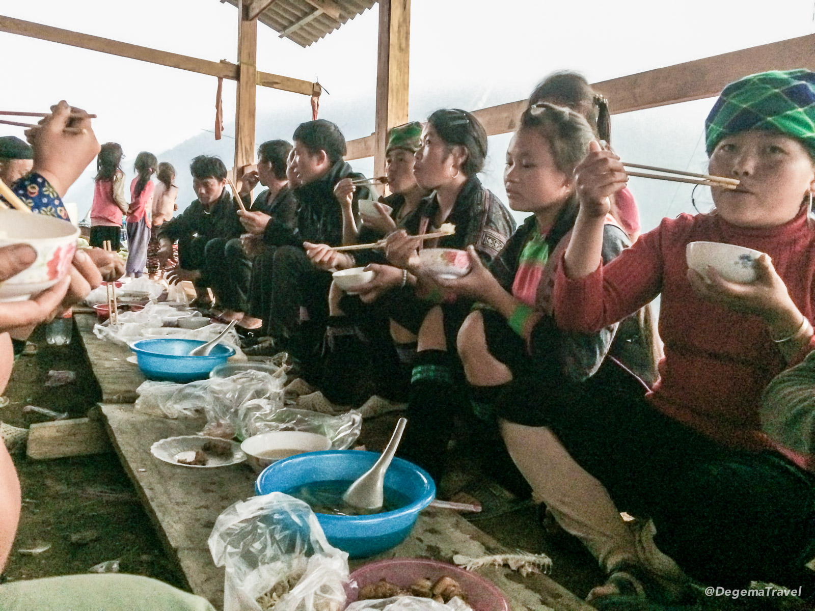 A communal meal in the house under construction in the Mường Hoa Valley near Sapa, Vietnam