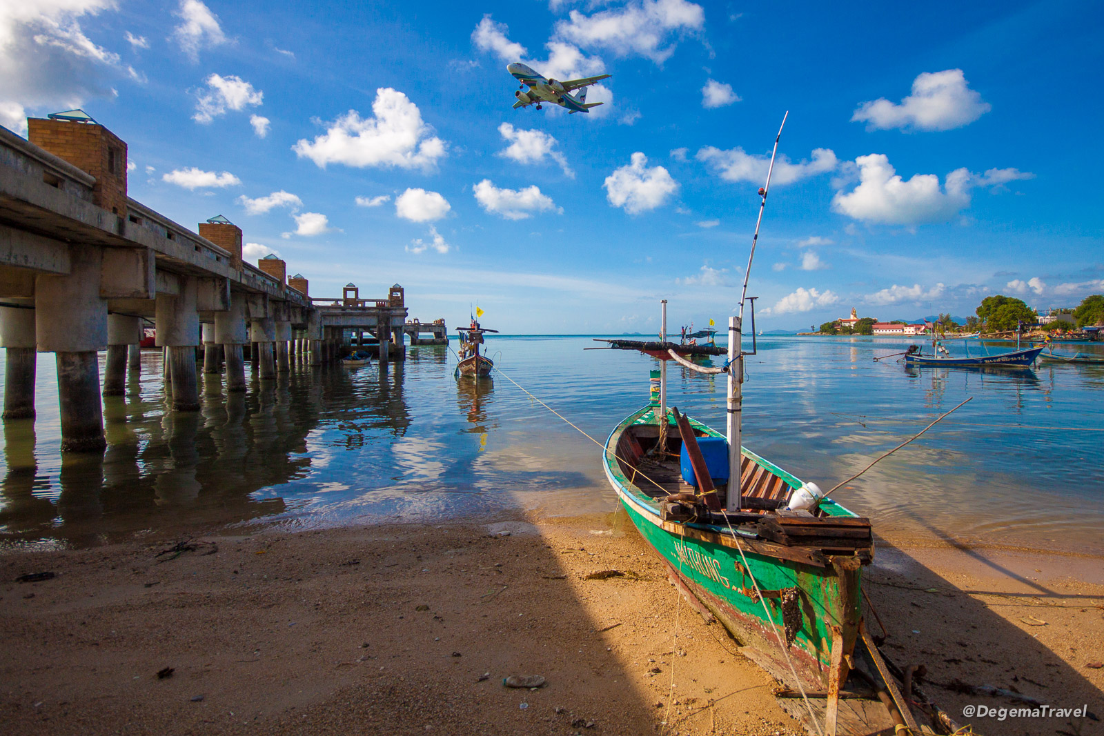 A fishing boat under the approach path to Koh Samui Airport in Thailand