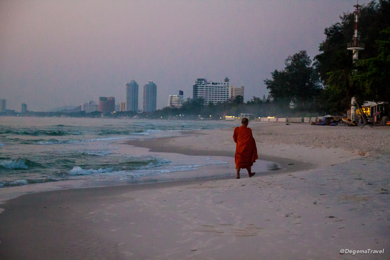 Monk walking on Hua Hin Beach, Thailand