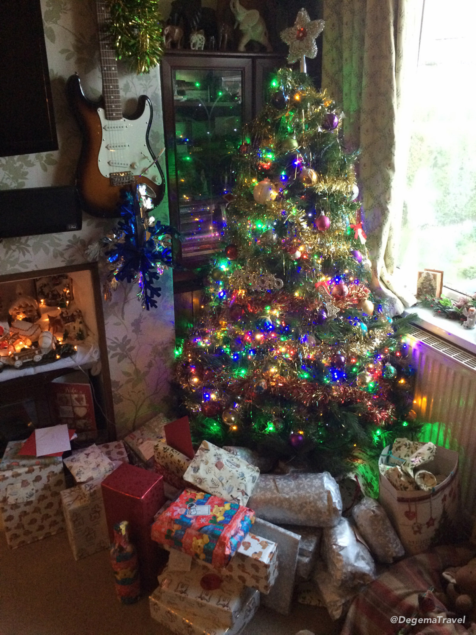 Mum's main Christmas tree, surrounded by gifts, in Selby, UK