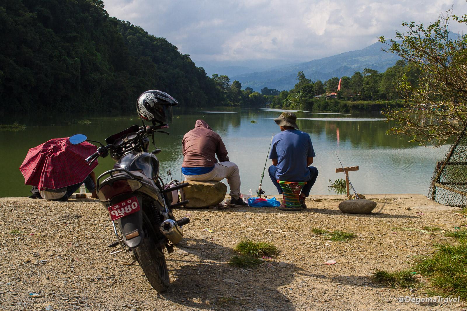 Fishermen at Phewa Lake in Pokhara, Nepal